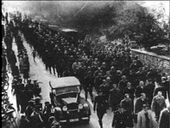 30,000 Jews being led to concentration camps after Kristallnacht