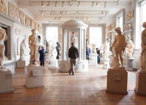 man appreciating museum and history